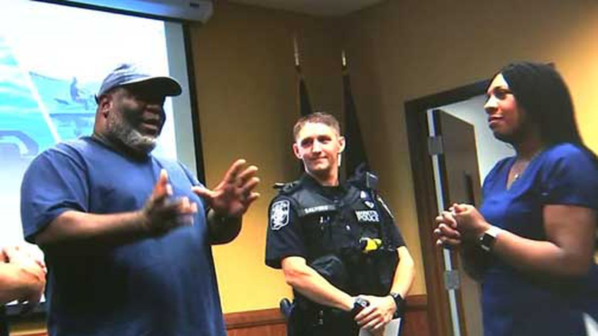 The couple thanked Officer Salyers for his actions during a reunion at Marietta Police headquarters. (Source: WSB/Cox/Marietta Police/CNN)