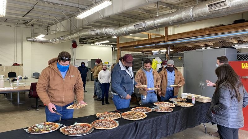 The REACH Project teamed up with Wild Garlic Pizza to feed over 60 of Texas A&M's maintenance...