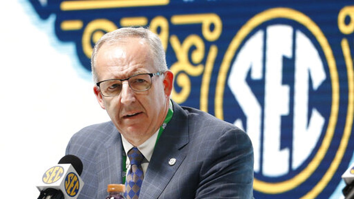Southeastern Conference Commissioner Greg Sankey announces Wednesday, March 11, 2020, that fans will not be allowed in the arena to watch NCAA college basketball games in the SEC tournament in Nashville, Tenn., starting Thursday. The Southeastern Conference joined the rest of the Power Five leagues and announced that only family and essential personnel would attend its men's and women's tournament basketball games. (AP Photo/Mark Humphrey)