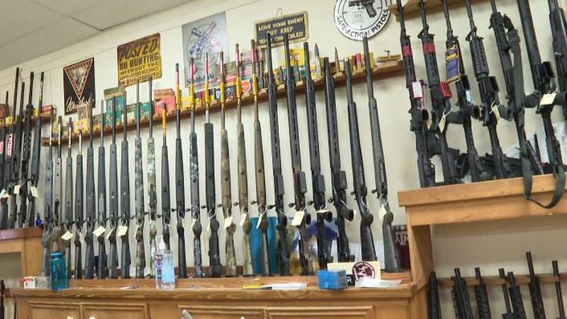 Guns hang on the walls at Burdett & Son Outdoor Shop in College Station.