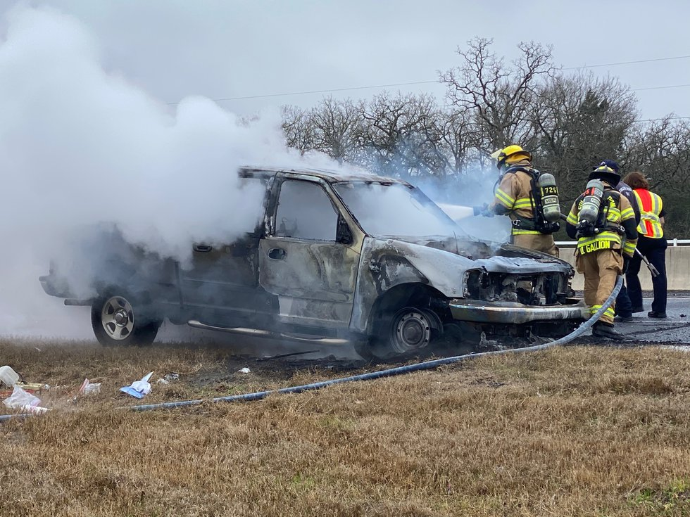 Firefighters put out flames after vehicle catches fire on Highway 6